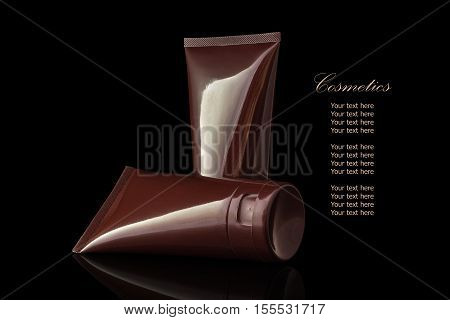 Brown Colored Blank Cosmetic Container For Face Cream Moisturizer Isolated On Black Background.