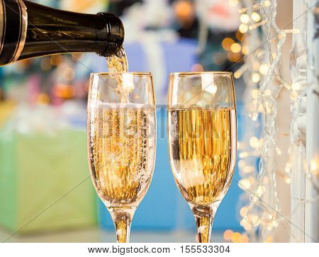 Two Champagne Glasses On Defocused Background Christmas Living Room With Christmas Tree