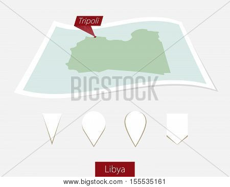 Curved Paper Map Of Libya With Capital Tripoli On Gray Background. Four Different Map Pin Set.