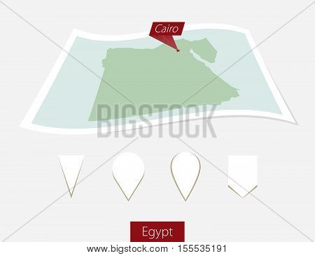 Curved Paper Map Of Egypt With Capital Cairo On Gray Background. Four Different Map Pin Set.