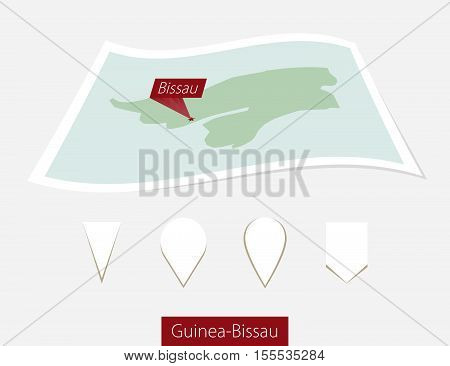 Curved Paper Map Of Guinea-bissau With Capital Bissau On Gray Background. Four Different Map Pin Set