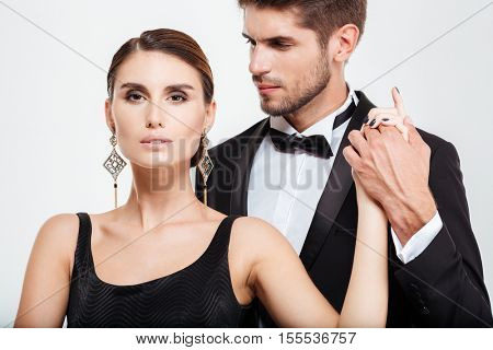 Cropped business couple. guy holding the girl's hand