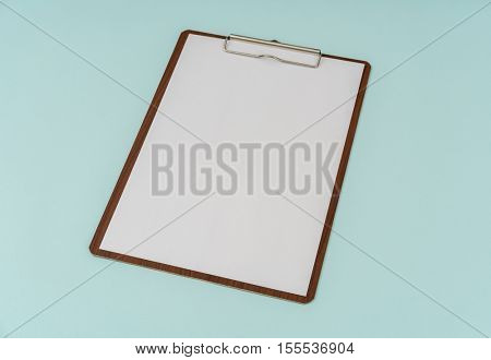 Clip board and paper on blue background