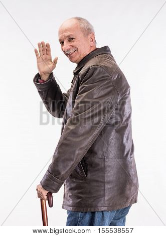 Happy Senior Man In Leather Jacket With Umbrella