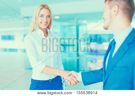 Two successful business people shaking hands with each other