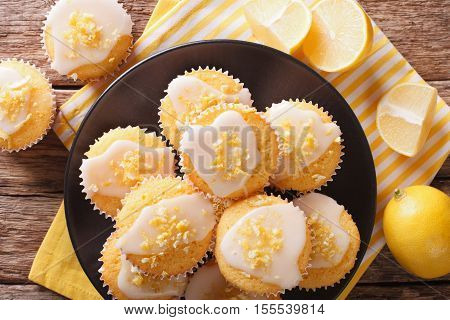 Breakfast Muffins With Lemon Zest And Icing Closeup On A Plate. Horizontal Top View