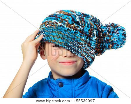Seven years boy with stylish hat on his face isolated on white background