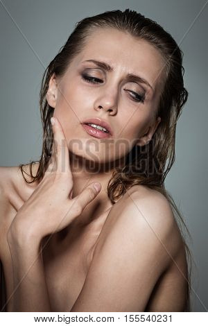 Portrait of a young brunette lady showing emotional expression