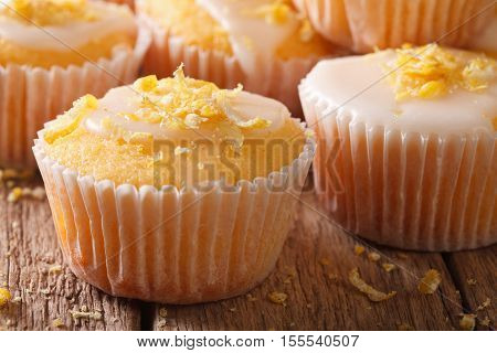 Delicious Lemon Muffins With Icing And Zest Macro. Horizontal