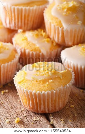 Delicious Lemon Muffins With Icing And Zest Macro. Vertical