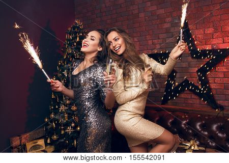 Two Beautiful Girl In Confetti With Champagne And Sparkle. Funny And Happy Girl Ni A Beautiful Sexy