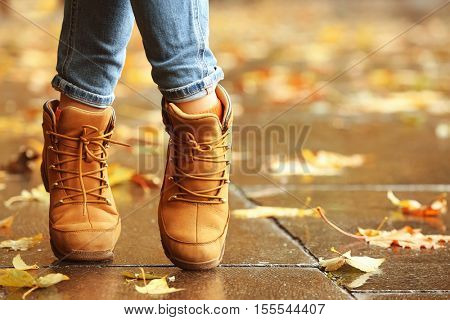 Woman walking on autumn street