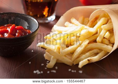 french fries with ketchup over rustic background