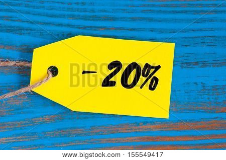 sale minus 20 percent. Big sales twenty percents on blue wooden background for flyer, poster, shopping, sign, discount, marketing, selling, banner, web