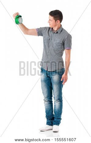 Full length portrait of a young man holding alarm clock. Handsome teen boy, isolated on white background. Caucasian young guy with creative idea for success and profit.