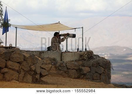 Golan Heights, Israel - October 31, 2016: UN Peacekeeper  on Mount Bental in the Golan Heights between Israel and Syria. Israel captured the Golan Heights in 1967 war and annexed it in 1981. Its not recognized internationally.