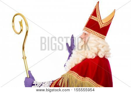 Dutch Saint Nicholas with staff sideview. isolated on white background. Dutch character of Santa Claus