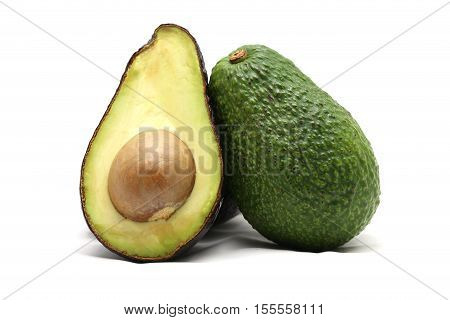 Green Avocado half isolated on white background