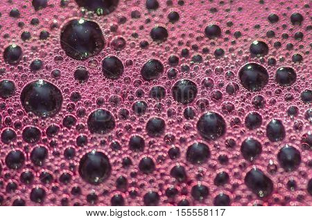 Bubbles the wort red wine during fermentation closeup background