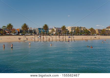MELBOURNE, AUSTRALIA - MARCH 8, 2015: St. Kilda beach in Melbourne is a popular place for swimming in the sea.
