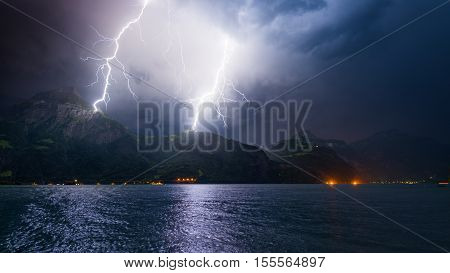 Mountain landscape by storm and rain. Discharge of lightning strikes the top of the mountains.