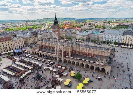 Market square Rynek Glowny with Cloth hall Sukennice and city hall tower in Krakow, Poland