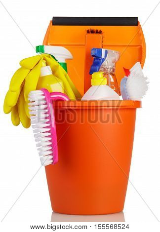 Plastic bucket with cleaning agents, brushes and gloves isolated on white background.