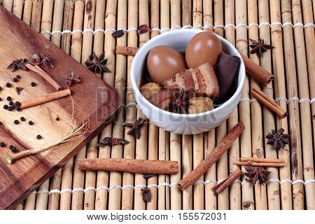 Thai Recipes : Stewed boiled egg with tofu and streaky pork call Khai Palo in Thai take photo with herbs as Chinese star anise cinnamonblack peppercilantro roots and stems is popular Thai food served
