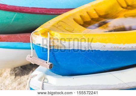 Multicolor Rowboat Or Sea Kayaks On Beach With Copy Space. In Holiday Time.