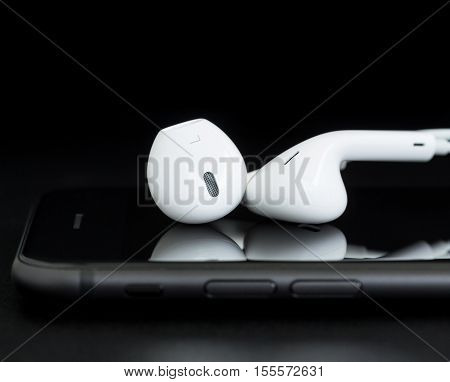 Bangkok Thailand - November 2 2016: Close-up earpods stack on iphone 7 new earpods use lightning cable connect to iphone 7