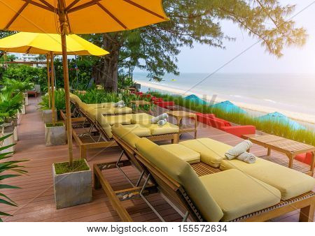 Wood Beach Chair  In The Resort Near Sea At Summer And Relaxing Time.