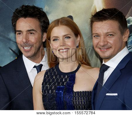 Shawn Levy, Jeremy Renner and Amy Adams at the Los Angeles premiere of 'Arrival' held at the Regency Village Theater in Westwood, USA on November 6, 2016.