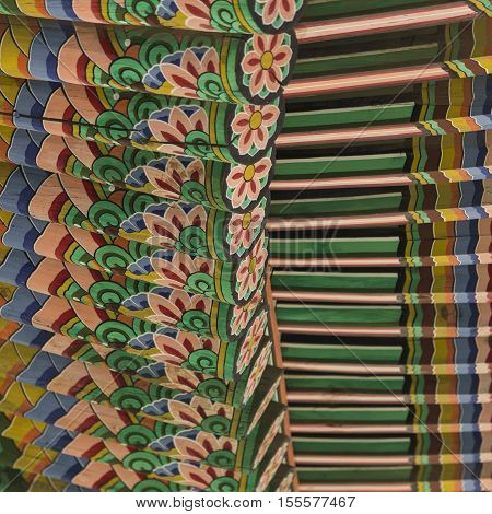 Detail of Traditional Korean Roof Colourful Decorated Ornament for Ancient Korean Palace or Temple at Seoul South Korea.