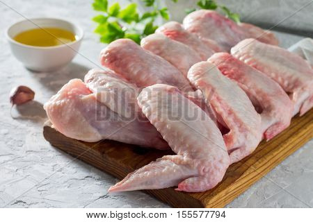 Raw Chicken Wings On A Concrete Table With Spices