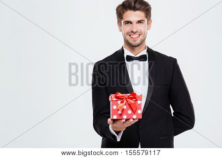Cool businessman with gift. looking at camera