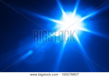 Diagonal blue glowing sun flare background hd