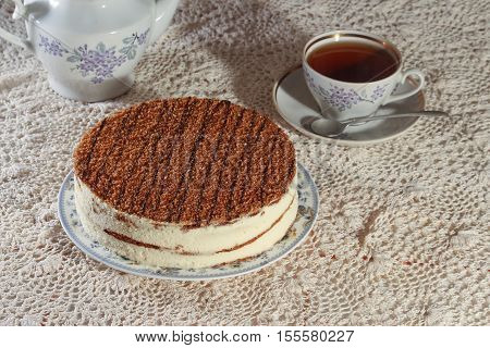 delicious cake on a plate and tea. delicious cake on a plate and tea. improper diet