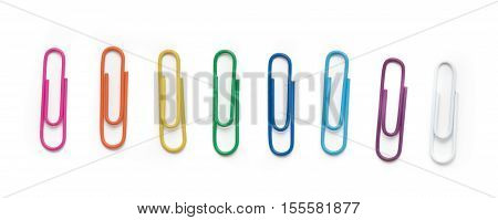 Colored paper clips on a white background. Top view.