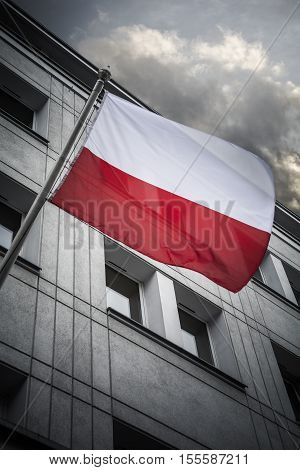Polish flag flying from city building in Gdansk