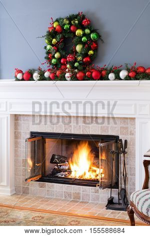 Christmas Fireplace With Baubles And Blazing Fire