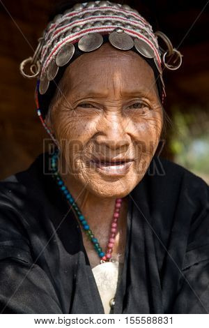 Mae Salong, Thailand - January 28, 2008 :  In the province of Mae Salong, north of Thailand.  An old woman from the Akha ethnic group rests in the shadow of her bamboo house