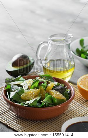 Fresh salad with avocado and orange, sprinkled with sesame seeds. Cope space for text