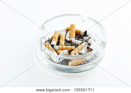 Cigarette Butts With Ash In Ashtray Isolated On A White