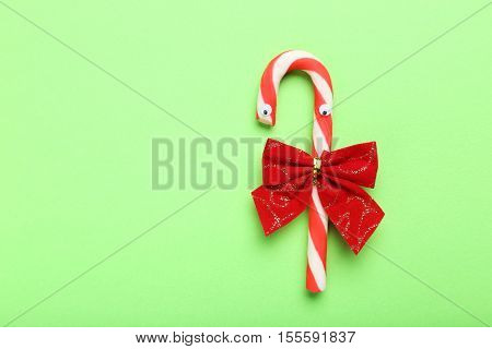 Christmas Candy Cane With Googly Eyes On Green Background