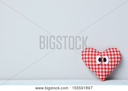 Love Heart With Googly Eyes On A Grey Background