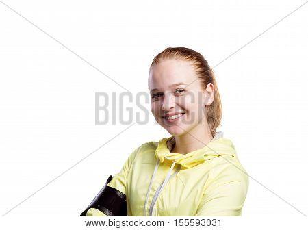 Teenage girl in neon yellow running jacket, wearing phone armband. Beautiful sportswoman. Studio shot on white background, isolated.