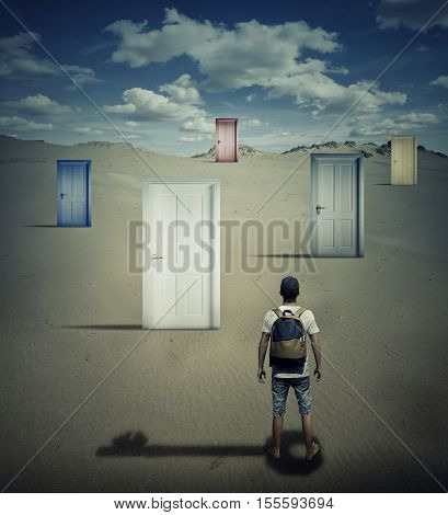 Conceptual image with a person standing in front of different closed doors dropping a key shadow choosing which one to open.