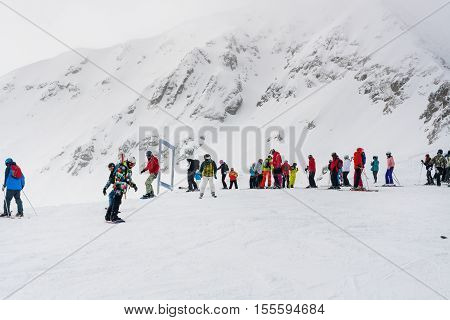 Bansko, Bulgaria - March 4, 2016: Ski resort, skiers at the high lift station, Bansko, Bulgaria