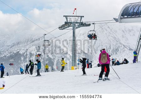 Bansko, Bulgaria - March 4, 2016: Ski resort view, skiers on lift,  people skiing on slopes, mountains on background