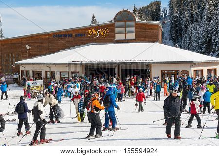 Bansko, Bulgaria - March 4, 2016: Bansko ski resort, ski lift station, cable car lift and people skiing
